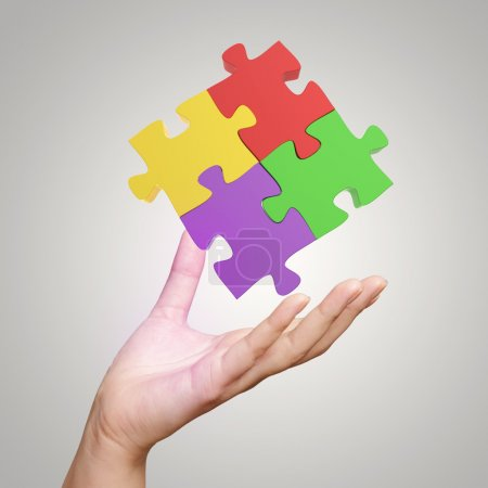 Hand showing 3d puzzle as concept