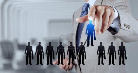 Photo pour Homme d'affaires main choisir gens icône comme concept de ressources humaines - image libre de droit