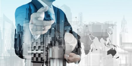 Double exposure of business engineer and abstract city as concep