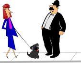 Man and lady talking on sidewalk