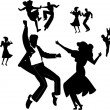 Dancers dancing the jive and swing from fifties in silhouette with enthusiasm