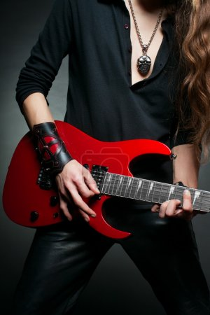 Photo for Hands of guitarist who playing electic guitar - Royalty Free Image