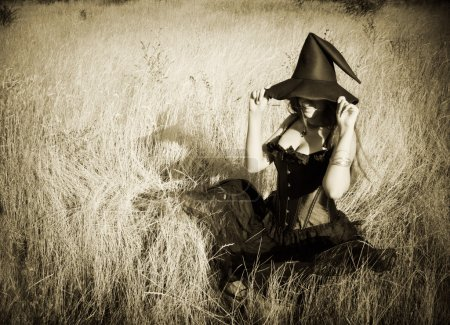 Pretty funny witch sitting in the field...