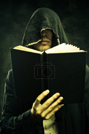 Portrait of sinister cultist in hood with book...