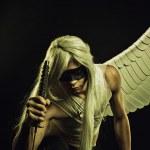 Brave and honourable angel posing with katana over...