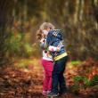 Little children hugging in the autumnal park...