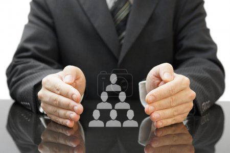Businessman's protecting  employees in his company. concept of e