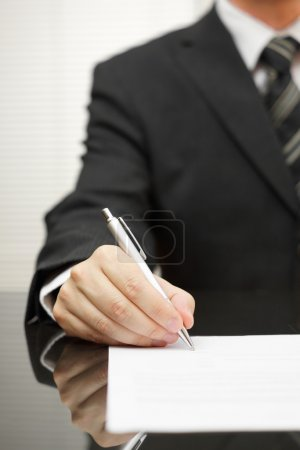 businessman is signing document