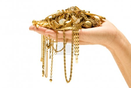 Hand Holding Expensive Gold Jewelry
