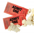 Close up or macro shot of red movie tickets and po...