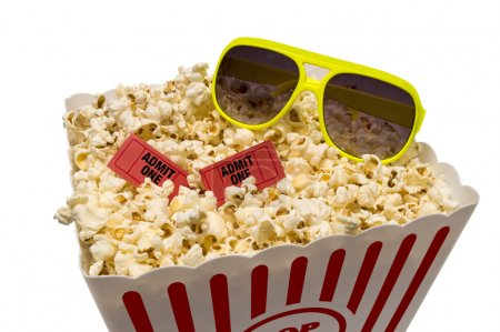 Close up shot of a large tub of popcorn with sungl...