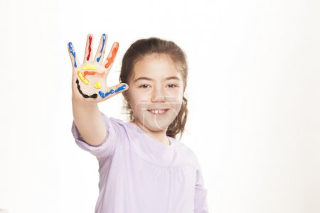 Photo for Colors stained happy and smiling little girl showing five fingers on white background - Royalty Free Image