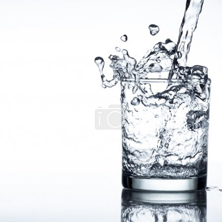 Photo for Water has a high speed and come out of the cup - Royalty Free Image