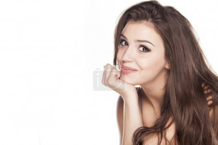 Photo for Smiling young woman leaning on her hand on white background - Royalty Free Image