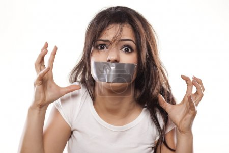 Self-adhesive tape over mouth