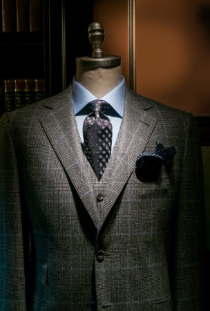Photo for Mannequin in gray checkered suit, blue shirt, dark tie and handkerchief. - Royalty Free Image