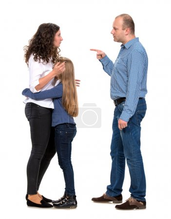 Sad looking girl with her fighting parents on a wh...