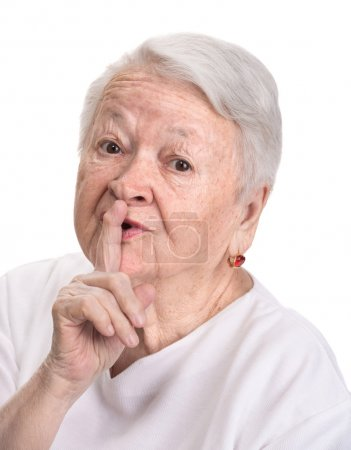 Old woman with finger on lips asking for silence