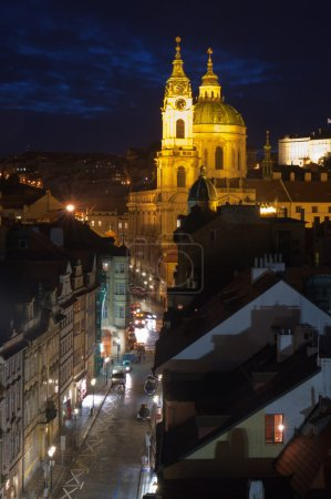 Photo for St. Nicholas Church with it���s robust dome and thin bell-tower is one of the leading baroque constructions in Europe and is usually defined as being the most beautiful building of Prague baroque. - Royalty Free Image