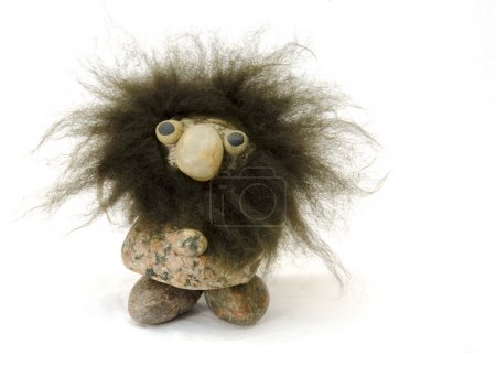Hairy troll made of stones isolated on white...