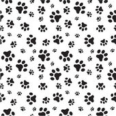 A random sized seamless pattern of dogs paws silhouettes