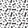A random pattern of dogs paws and bones