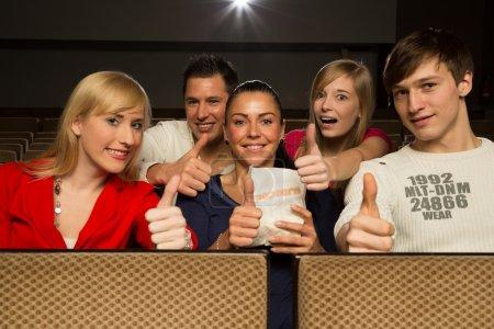 in a movie theatre having fun