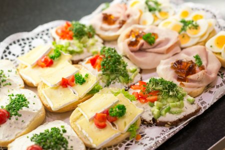 Sandwiches with cold cuts on a tray