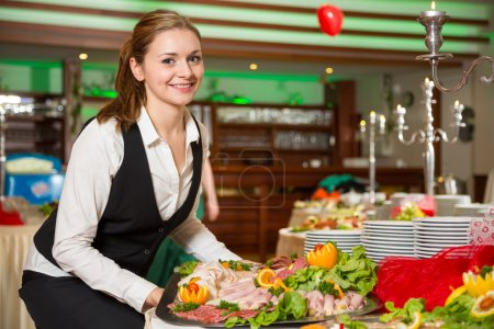 Photo for Catering service employee or waitress preparing a buffet - Royalty Free Image