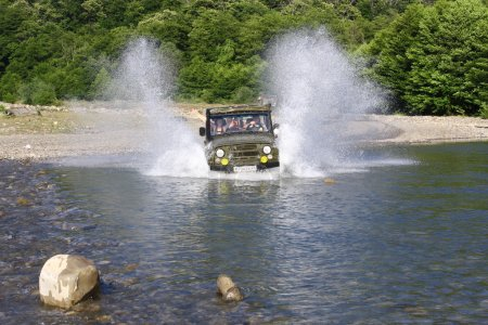 A jeep speeding along a