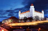 Bratislava castle from parliament at twilight with dramatic clou
