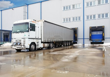 Photo for Unloading big container trucks at warehouse building - Royalty Free Image