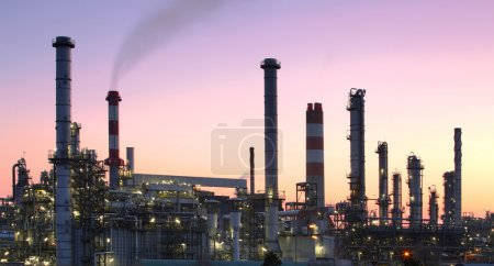Photo for Oil refinery factory silhouette over sunset - Royalty Free Image