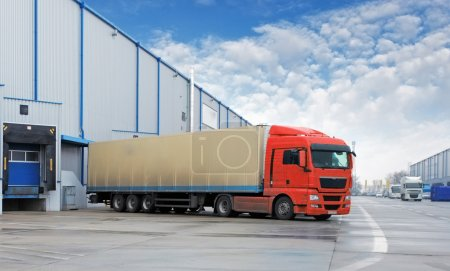 Photo for Cargo Transportation - Truck in the warehouse - Royalty Free Image