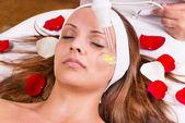 Beautician face treatment