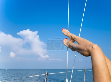 Photo for Closeup on beautiful sexy women's feet on the yacht - Royalty Free Image