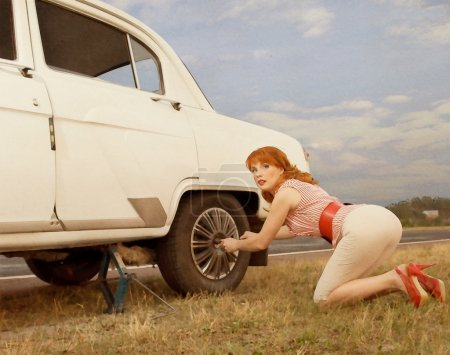 Photo for A young beautiful woman changing a tire. Pin up style - Royalty Free Image