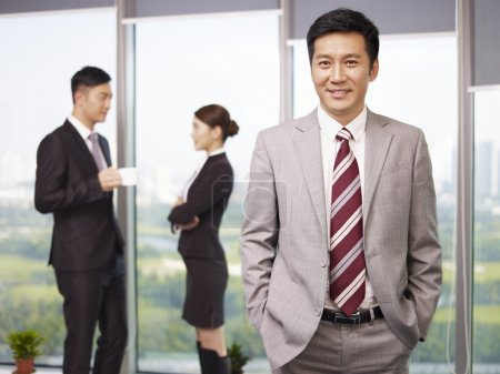 Portrait of a senior business executive with his c...
