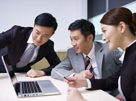 Photo for A team of asian business working together in office. - Royalty Free Image