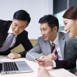 A team of asian business working together in offic...