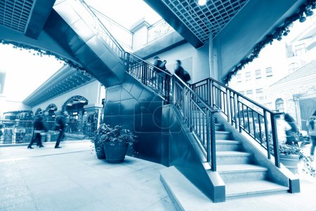 Low section of busy business people ascending on office stairs
