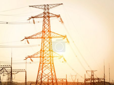 Transmission power line on sunset