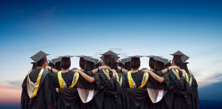 Back of chinese graduates with blue sky