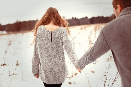 couple walking in cold field