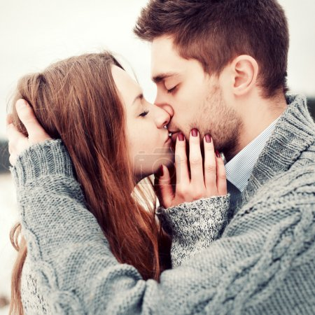 Photo for Young couple outdoor portrait. Beautiful pretty girl kissing handsome boy. Sensual photo - Royalty Free Image