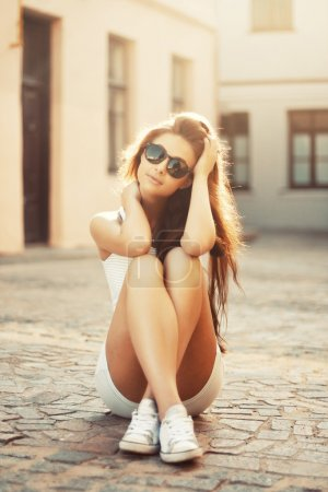 Photo for Beautiful girl sitting on a warm sunny day - Royalty Free Image