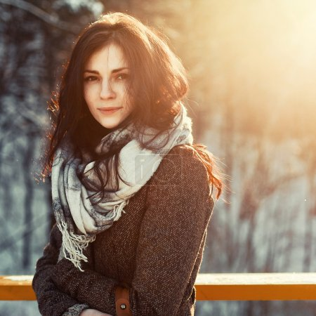 Photo for Sunny outdoor winter portrait of young attractive woman. Pretty girl smiling in winter on the street. - Royalty Free Image