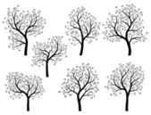Abstract silhouettes of spring trees with leaves