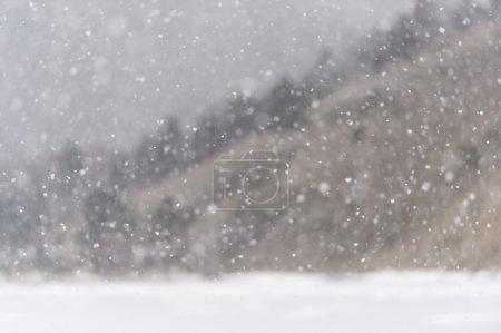 Snowfall on winter Baikal lake