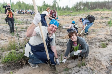 Volunteers planting trees for a new forest, Russia